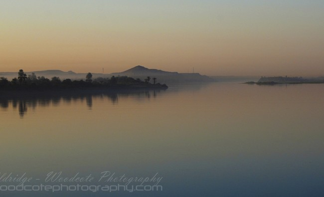Dawn breaks through the mist on the Nile, near Komombo