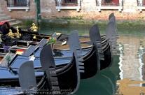 """Gondolas parked in a side """"street"""" in Venice"""